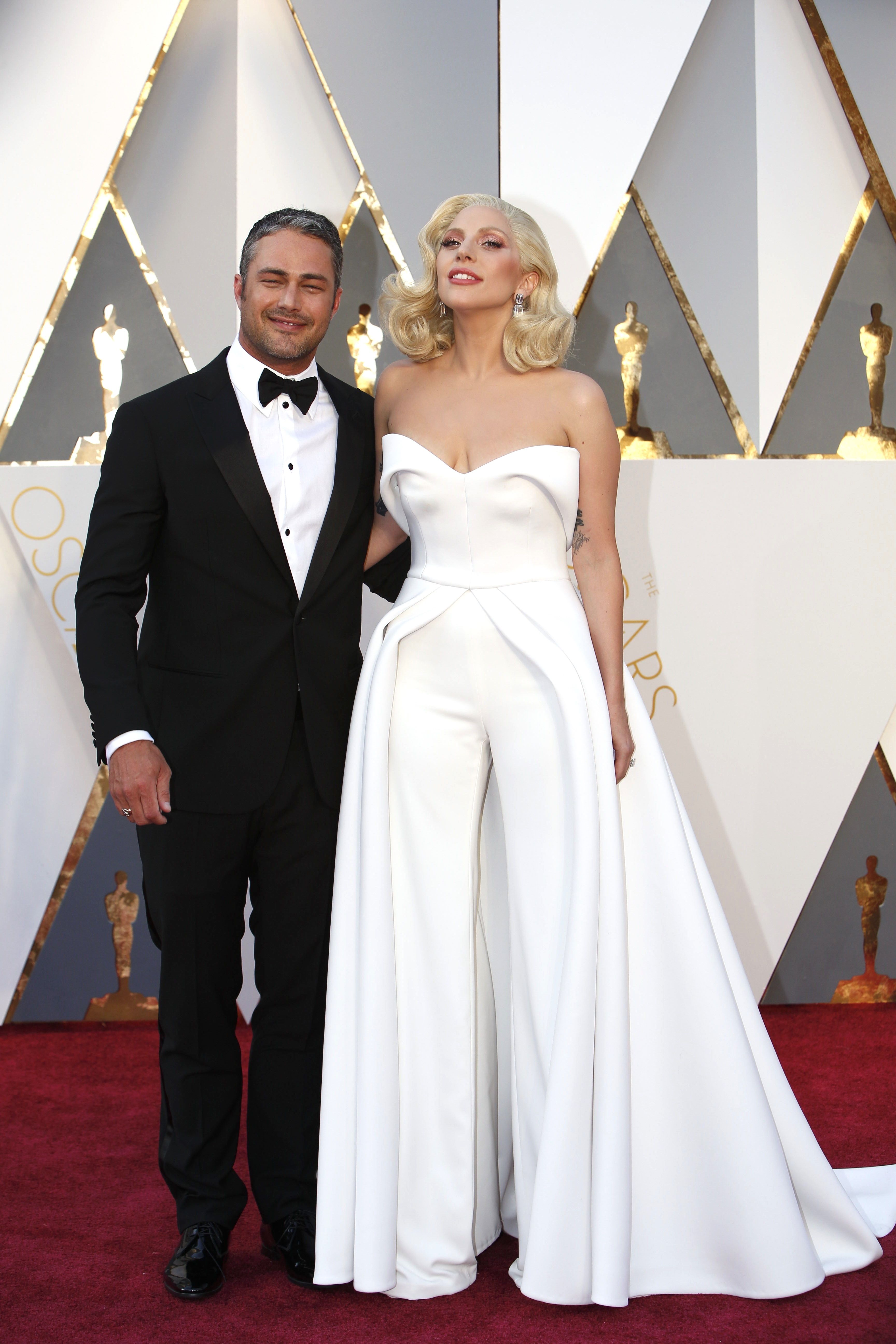 Lady Gaga arrives on the Oscars red carpet for the 88th Academy Awards  wearing a white jumpsuit by Brandon Maxwell. 7ae4f3d70