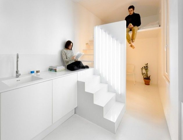 Small-Floorplan Paris Apartment Renovated With Modern Lighting Solutions. with large window from garage door behind -oriented other way?