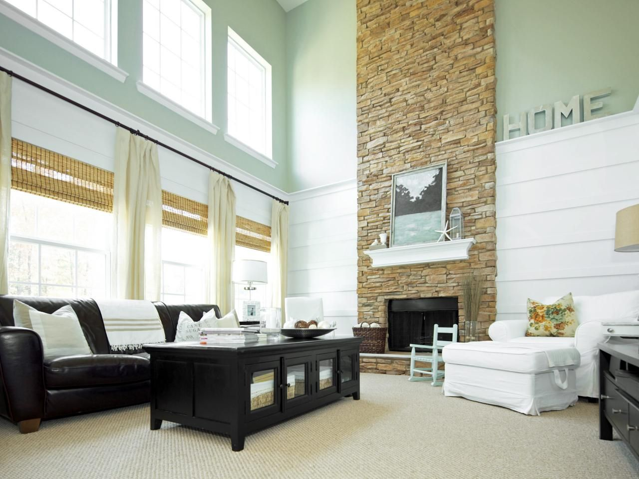 A dramatic floor to ceiling stone fireplace is the focal for Focal point flooring