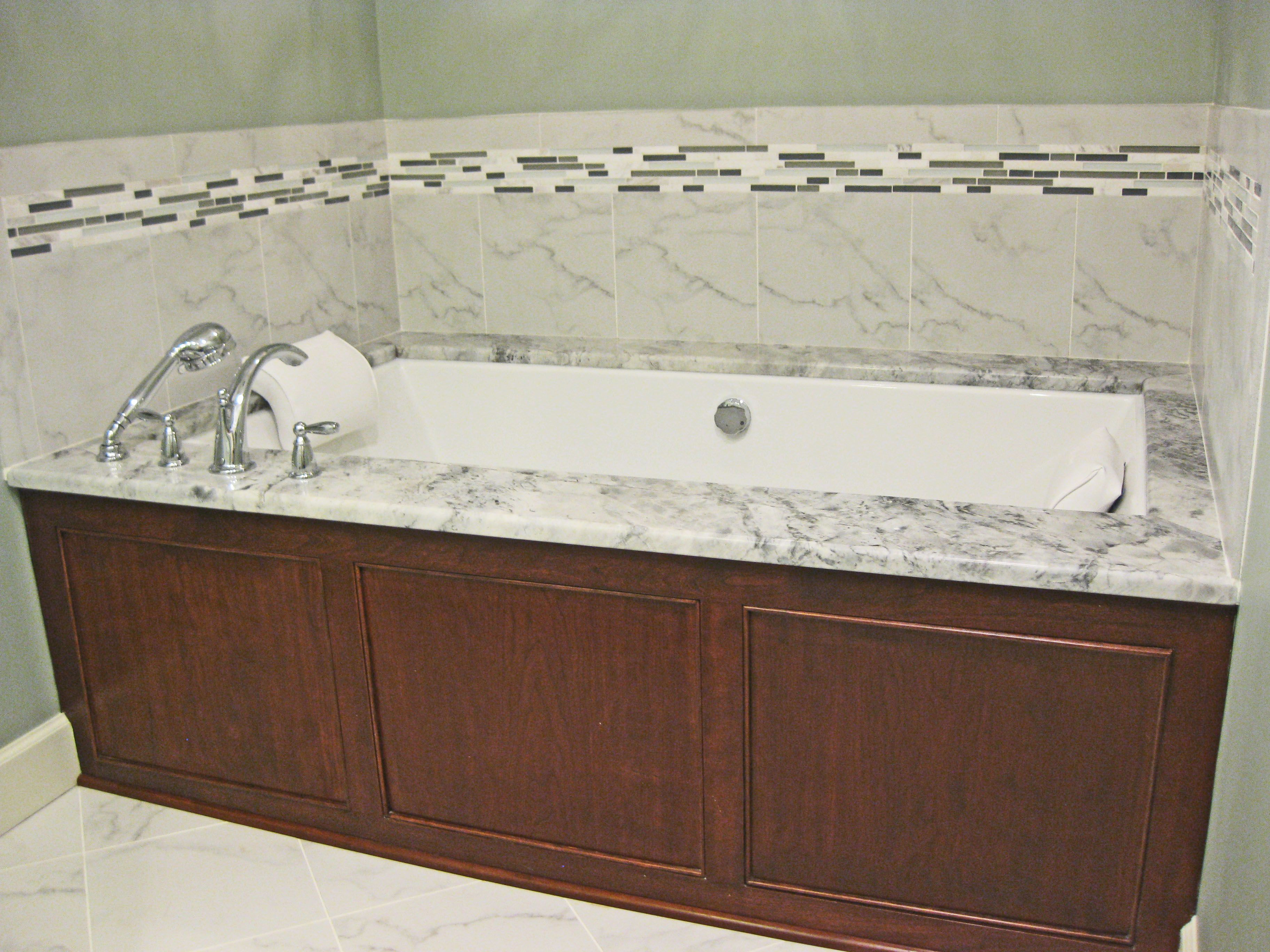 Undermount jacuzzi tub with super white granite surround and white ...