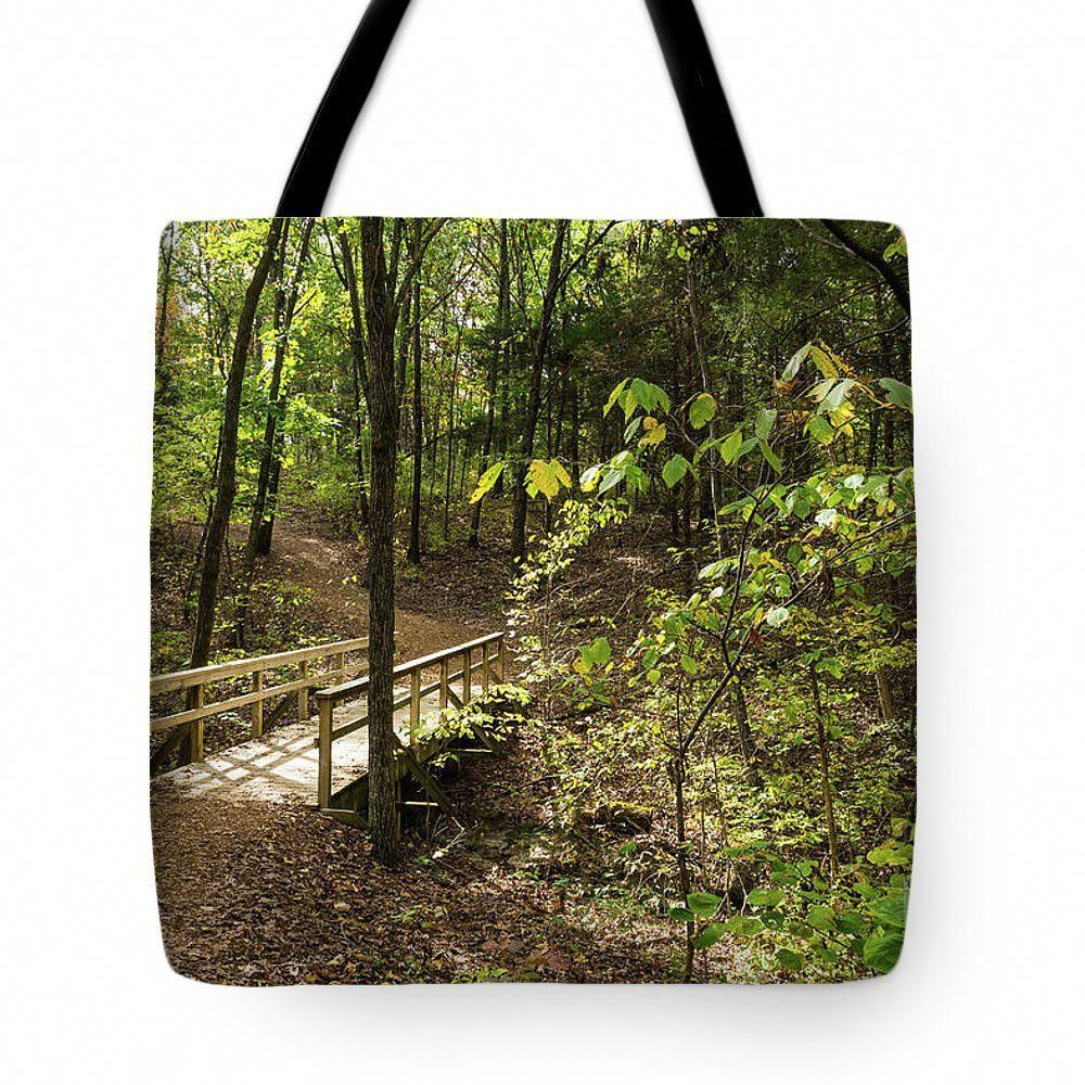 A Tote Bag featuring an autumn photo from Jefferson City Missouri of a walkway trail and bridge in Runge Conservation Park by Jennifer White Timeless Moments Photography. These tote bags are great for so many things. They work as purses, grocery reusable bags, work bags, carry on bags, travel, beach and so much more. Available in a variety of sizes.