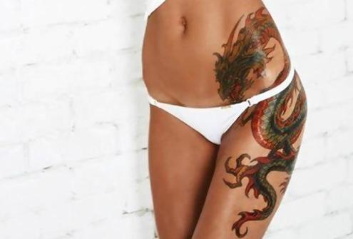 Amazing dragon tattoo on a beautiful posterior chain. Inspiring, roar!