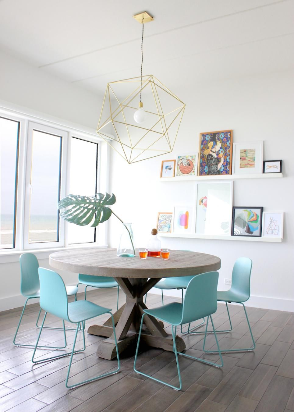 A round wooden dining table softens the
