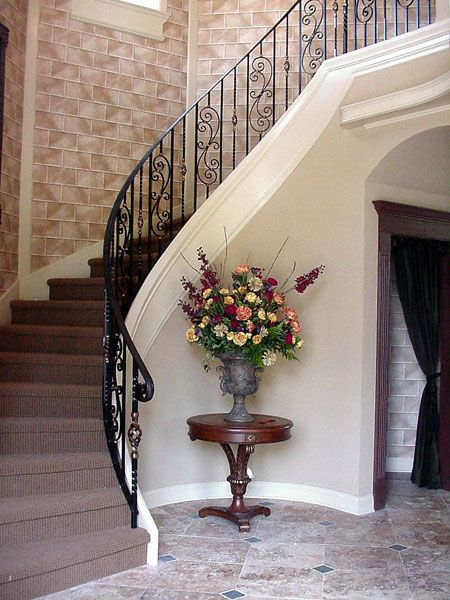 Curved Staircase Railing With Scroll Border