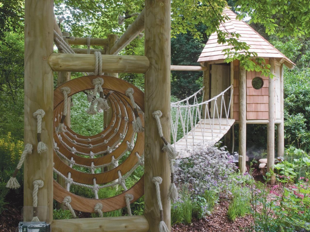 timber playhouse with bridge and jungle gym hgtv