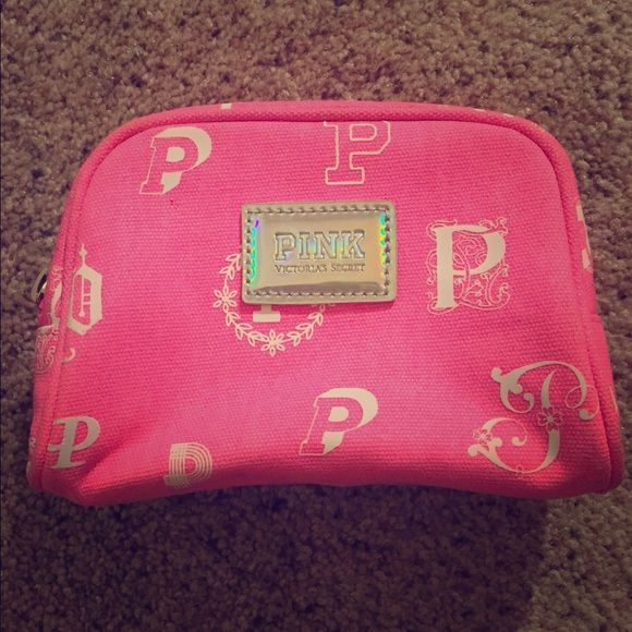 NWOT pink Small makeup bag Plastic inside so easy to clean, cute design and fits perfect in purse. Plastic zipper PINK Victoria's Secret Bags Cosmetic Bags & Cases