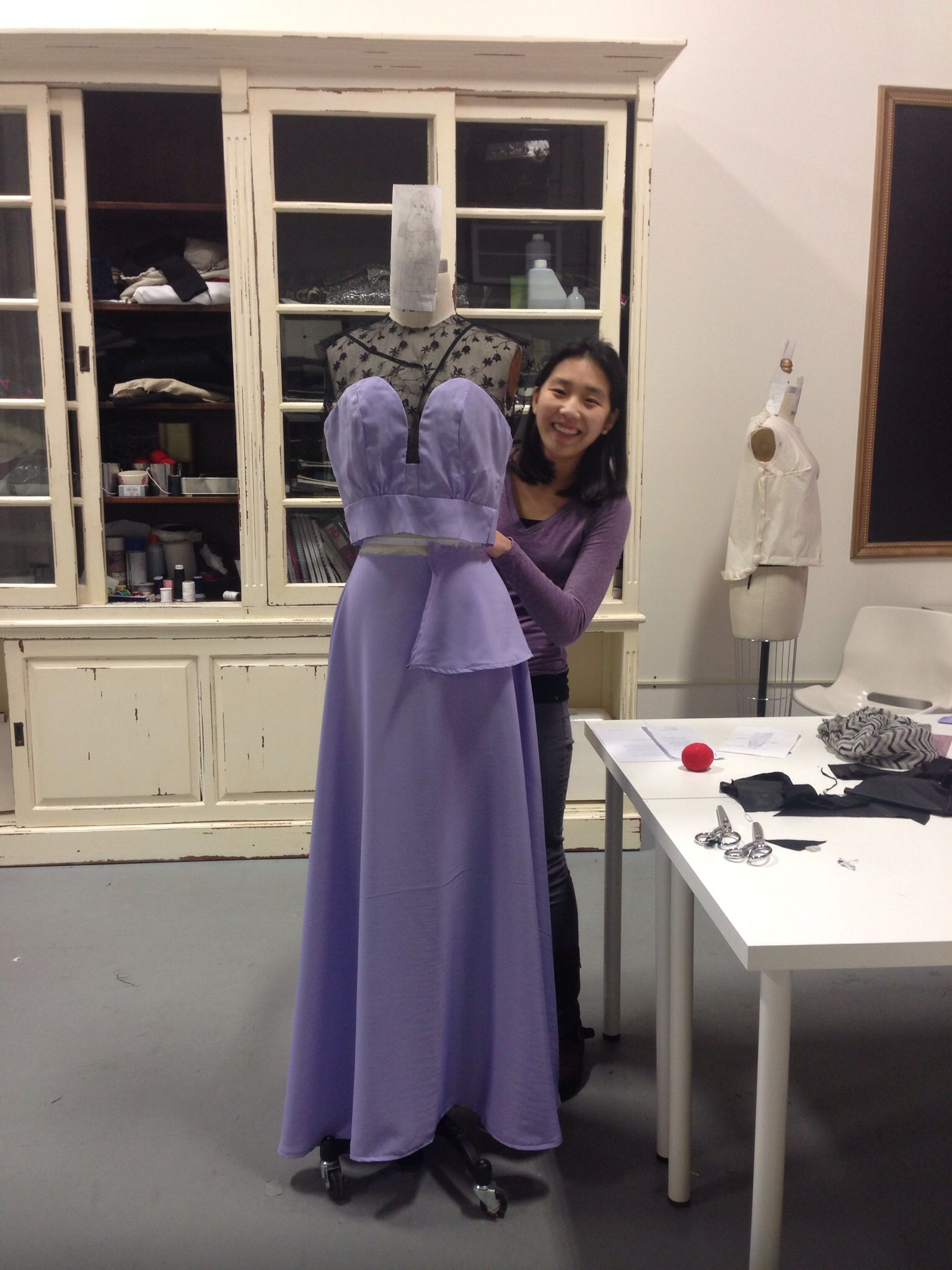 My student finishing up a dress for a competition only at