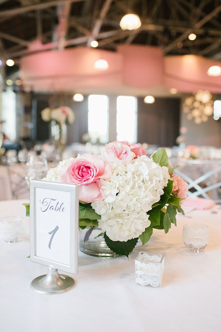 Pink Roses And White Hydrangea Centerpieces For A Summer Wedding