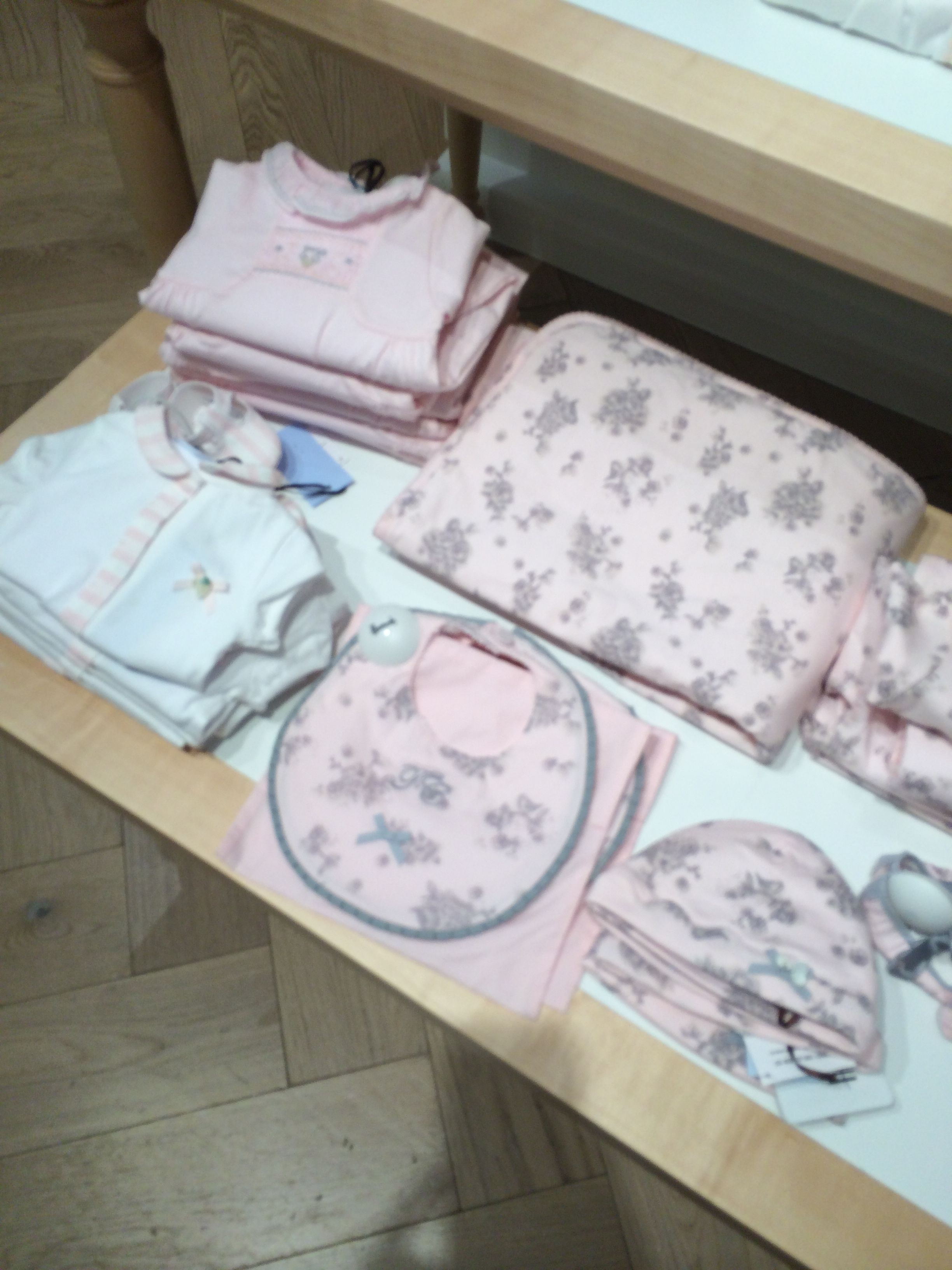 Harrods layette table presentation; sketchy grey floral