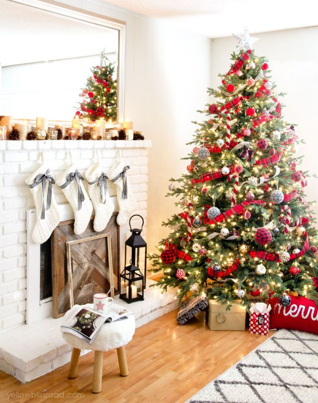 Inspired by Pottery Barn's holiday catalogue, blogger Kristin opted for pops of plaid, gold, and white in her decked out living room.  See the full tour at Yellow Bliss Road.   - CountryLiving.com