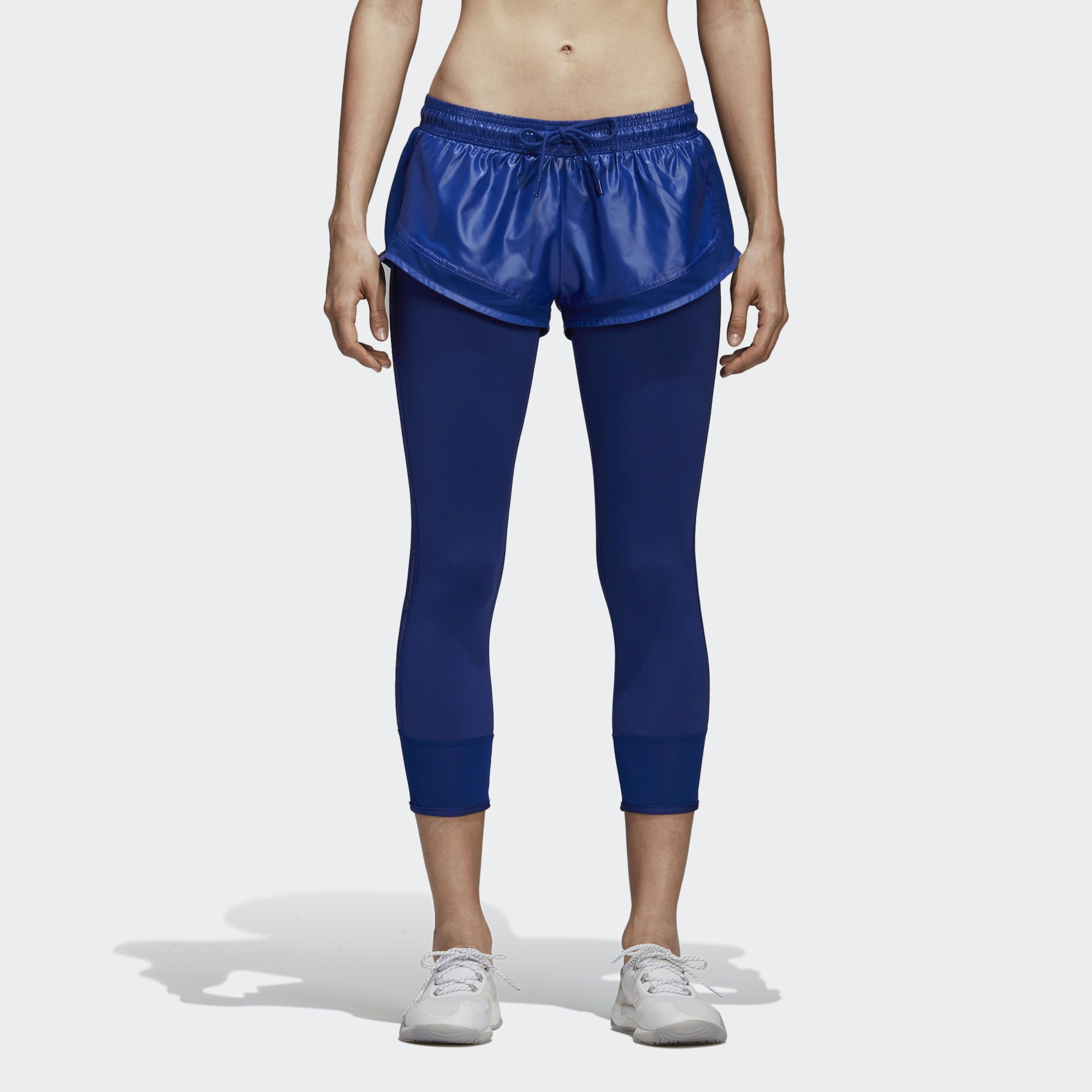 1741c06ef8fa03 The adidas by Stella McCartney Performance Essentials Shorts Over Tights  have built-in leggings for extra coverage during your workout.