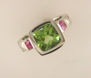 Maybe the sides with a Emerald for Bella, and an Aquamarine for Logan. Cute Mother's ring.