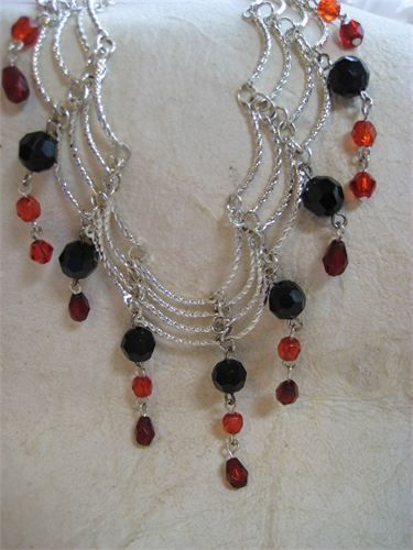 """Silver Swoops Necklace    $19 : Pretty silver necklace with black and red dangles. Lays really pretty around the neck at 16"""" with a 3"""" extender chain and silver lobster clasp. item # 6941A"""