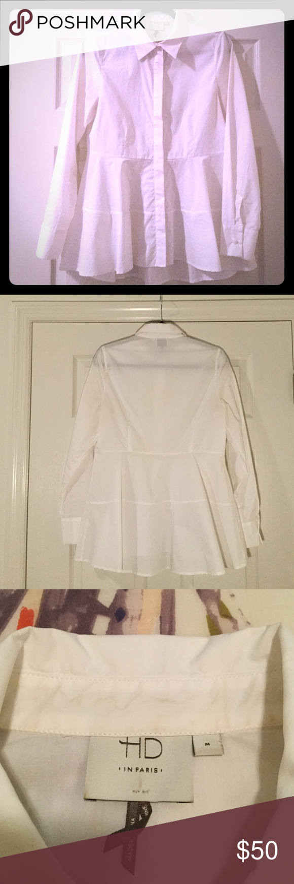 White blouse by HD in Paris This crisp white blouse adds flair to a classic style! The front features a panel to hide the buttons - which do run the full length of the piece. The fit is classic shoulder to waist, below the waist the material flares. Condition: barely worn. Anthropologie Tops Blouses