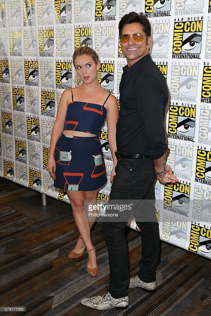 Actors Billie Lourd and John Stamos attend the 'Scream Queen' press line during Comic-Con International 2016 on July 22, 2016 in San Diego, California.