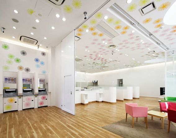 14 Different Colors Of Chairs Creates A Playful Atmosphere Inside Sugamo  Shinkin Bank. Design By Photo