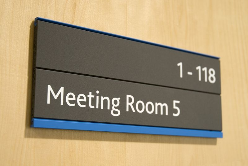 in a meeting sign for door