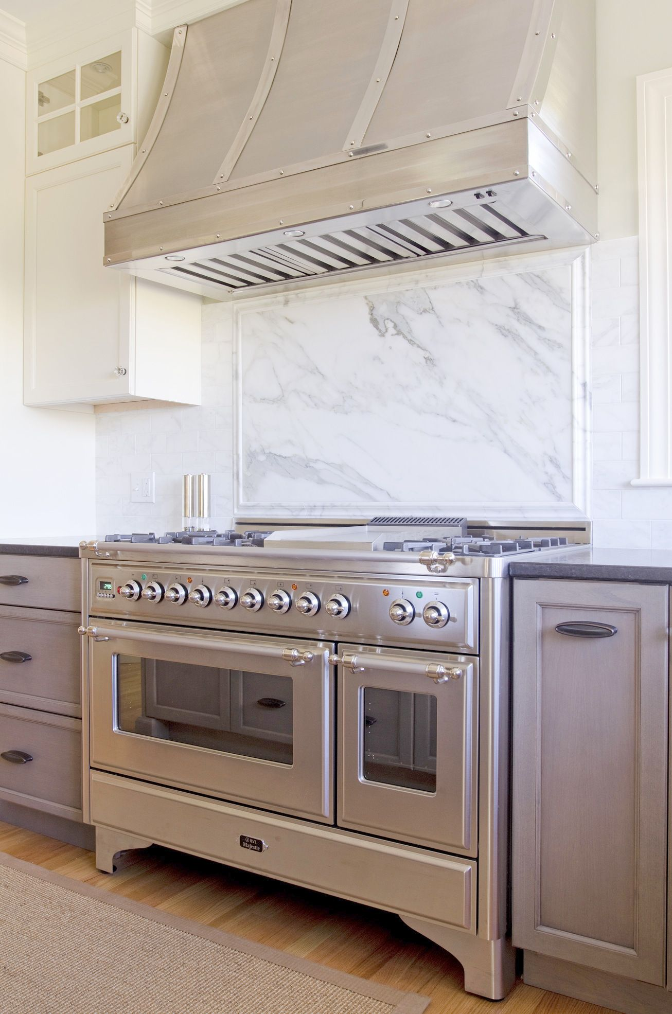 """Majestic 48"""" Stainless Steel Kitchen Cove Cabinetry - Maine, USA Photo by Jamie Salomon"""