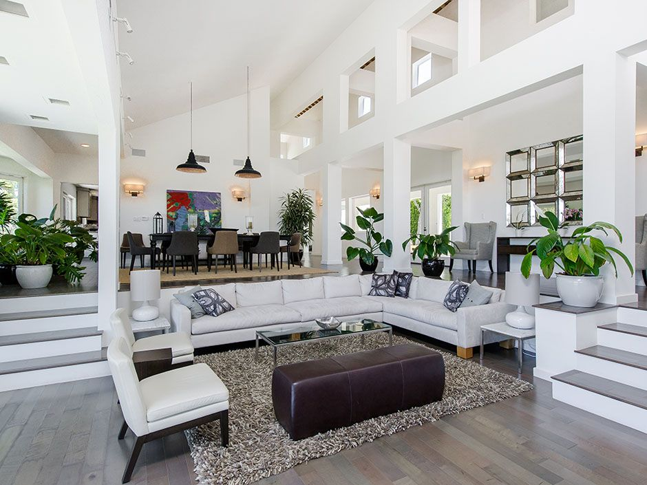 Enter into the expansive step-down living room that ...