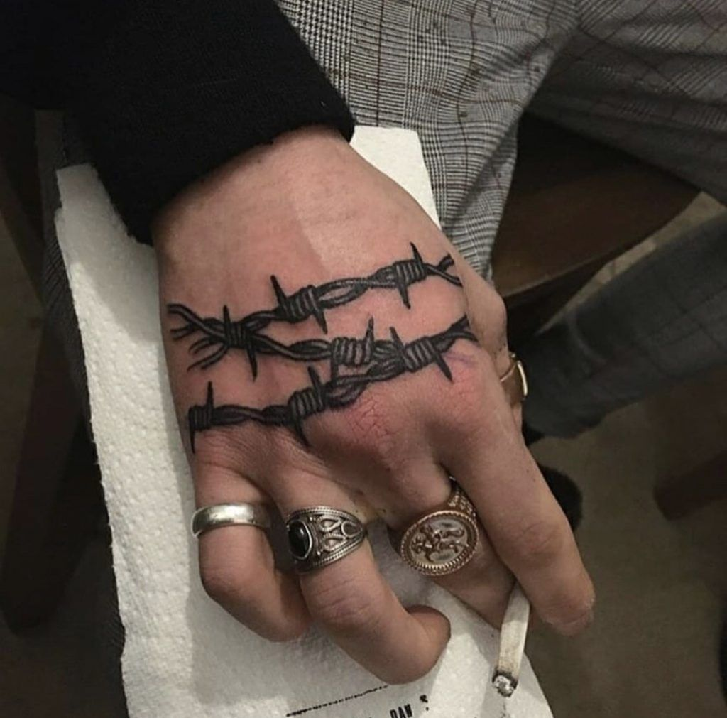 Barbed Wire Tattoo On The Right Hand Hand Tattoos For Guys Hand Tattoos For Women Hand Tattoos