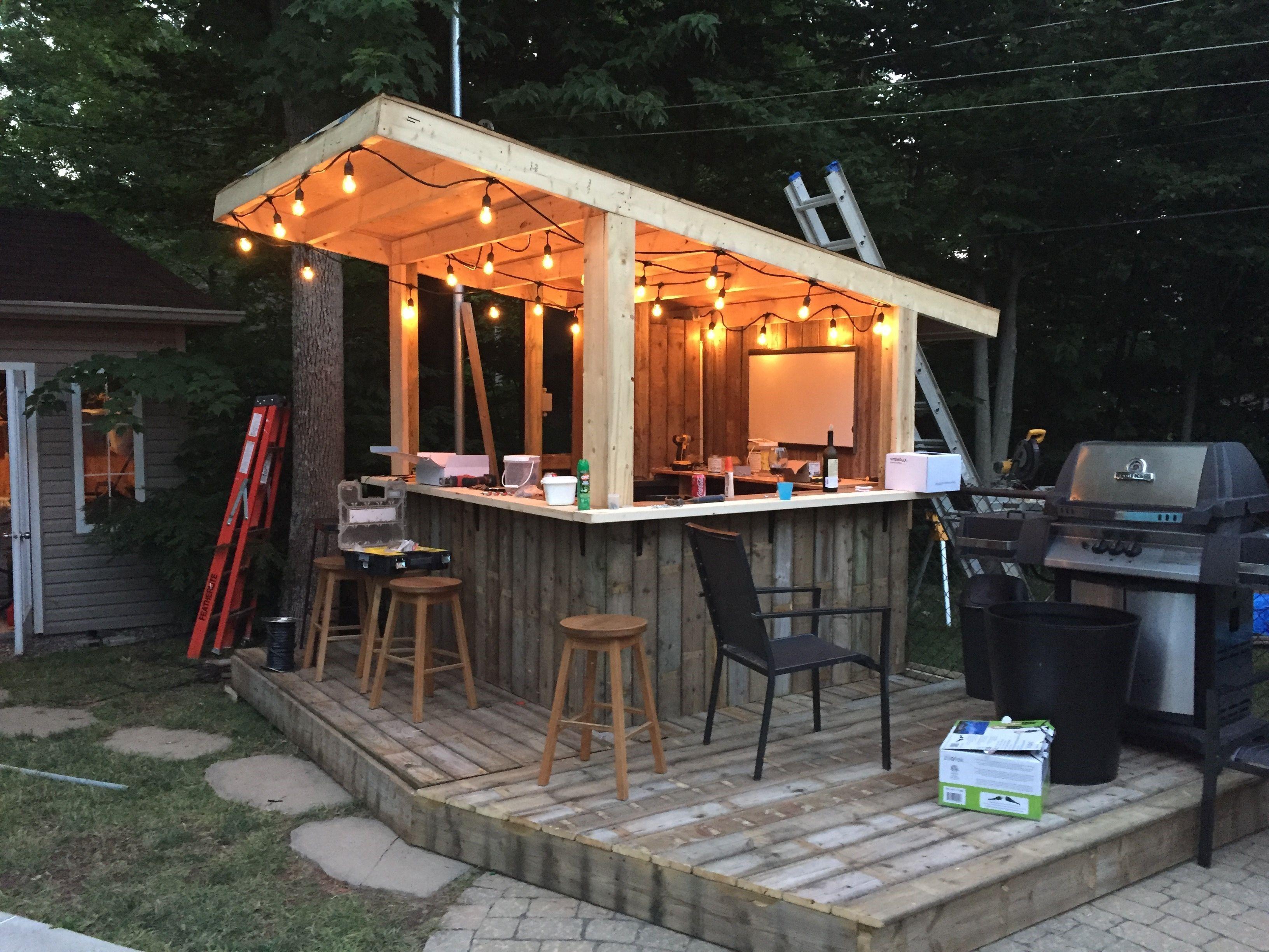 Shed DIY Tiki Bar Backyard Pool Bar built with old patio wood