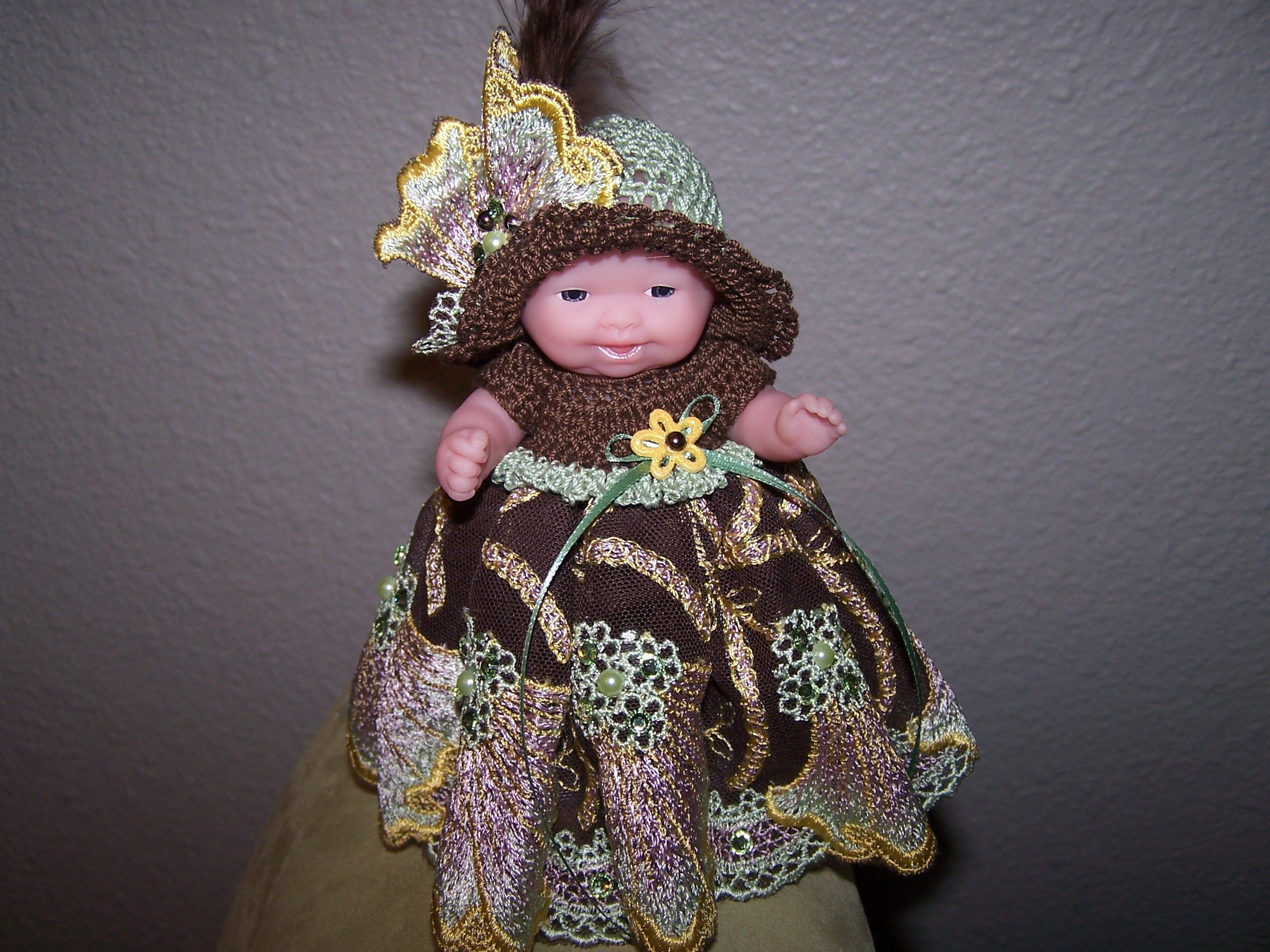 # 804 Brown/Green/Gold lace dress with matching hat.