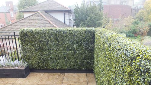 Balcony Garden Ideas with GreenSmart Decor | Deluxe Buxus Boxwood Artificial Hedge Panels, perfect safety solution for pets and small children