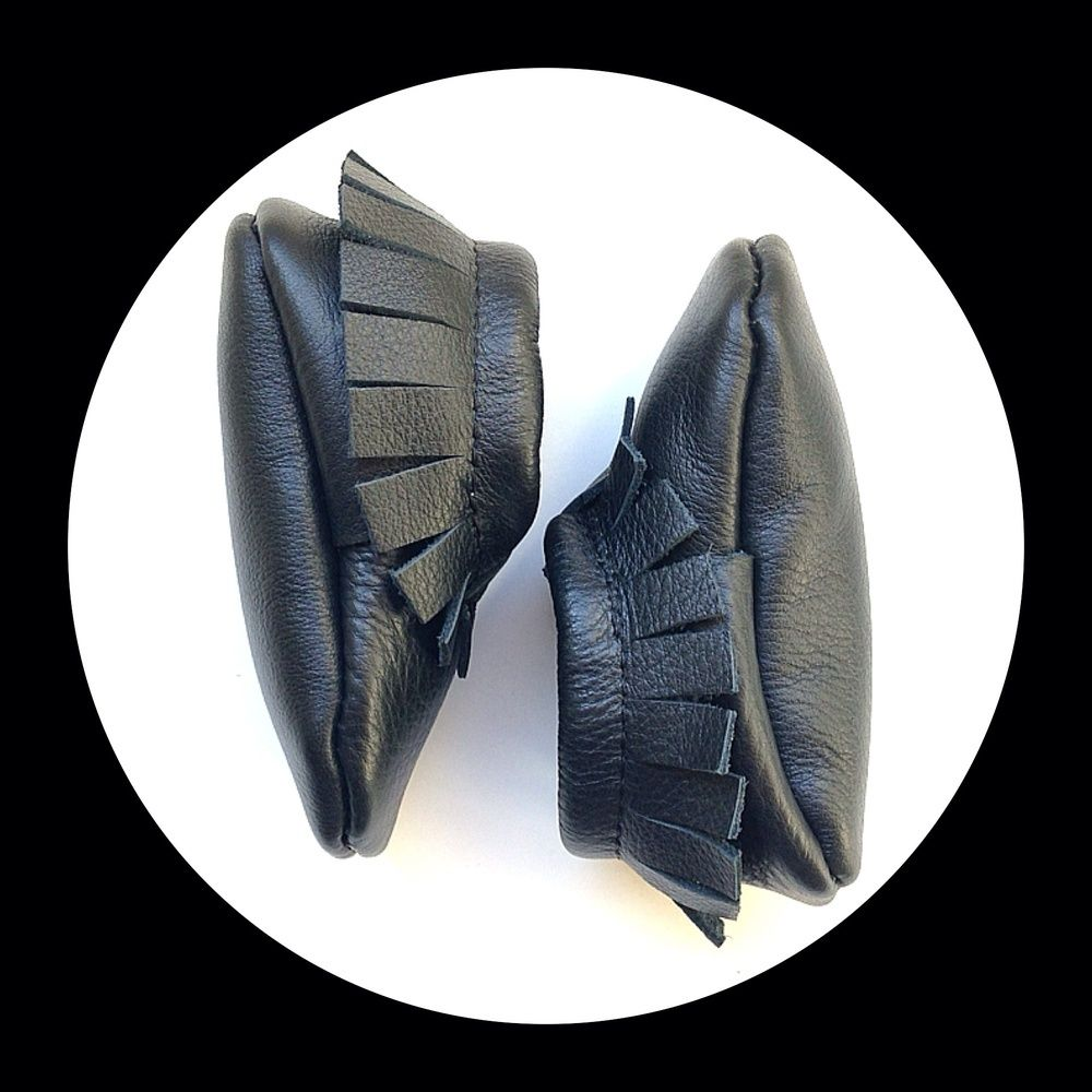 These soft soled shoes offer plenty of wiggle room in the toe box of your child's foot to develop without restriction. And the elastic opening allows flexibility for the shoe to grow with your child yet keep the shoe on your child's feet.This Moc is made out of genuine leather!!! It is 100% leather:)Limited supply!! These will come and go as I find good quality leather! All shoes are made to order. They will be made and shipped within 2-3 weeks of the order being place...