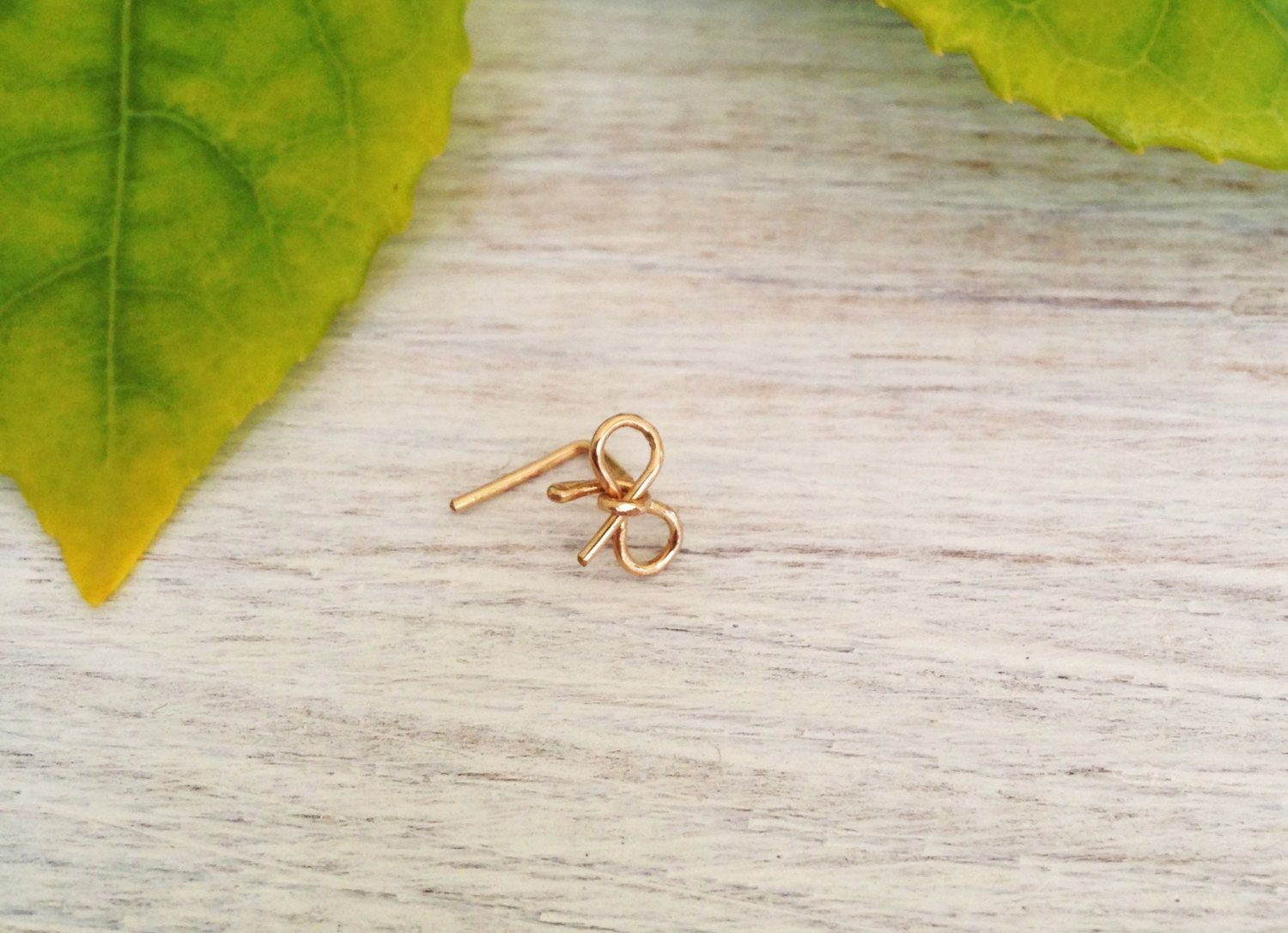 Bump from nose piercing  Bow Nose earring k gold nose ring tiny gold nose by lovemay