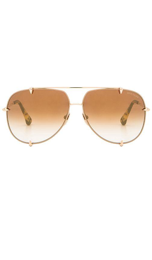 546eb499d47 Shop for Dita Talon Sunglasses in Satin Tan   12K Gold at REVOLVE. Free 2