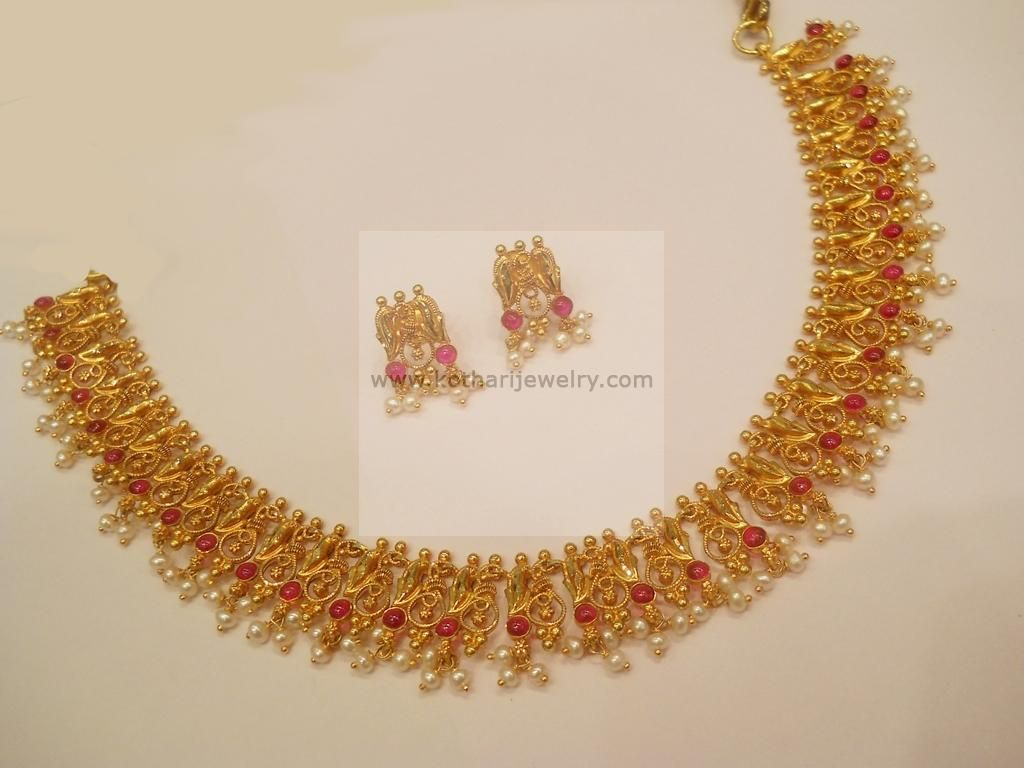 Necklaces / Harams - Gold Necklaces / Harams (NK27382247) at USD 1,356.72 And EURO 1,215.69