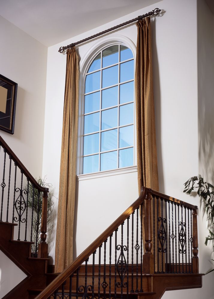 Tall Foyer Window Treatments : Home decorators have used tall drape panels in this foyer