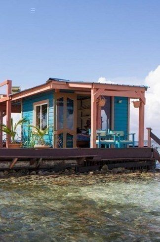 by foliage collection fp news tropic charming in beach rooms groves bay village are of villa portfolio grows cottages amongst curio belize s mahogany and club style coconut debut nestled resort hilton palms with