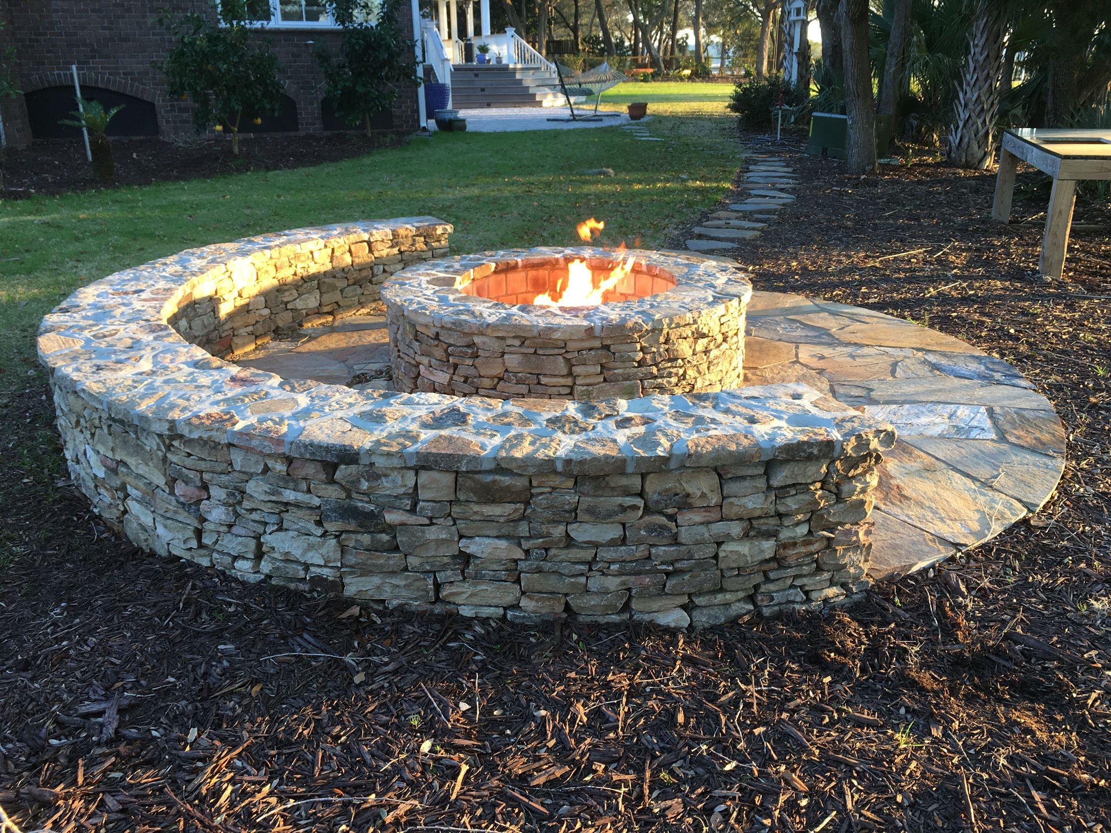 Stone fire pit designs patio traditional with artistic hardscape - Patio Plans Classic Half Moon Stone Firepit With Gas Starter