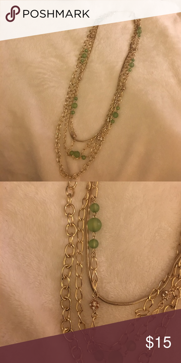 Long Multiple Layer Necklace Multiple bold gold chains mixed with pale green beads and rhinestone clusters. Gorgeous. Excellent Condition Jewelry Necklaces