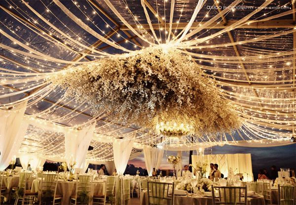 Suspended flowers in a dramatic draping