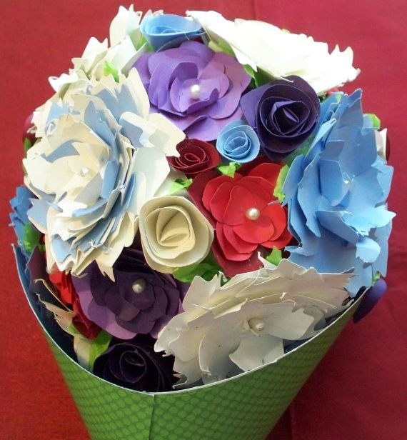 This gorgeous arrangement features spray roses, mums, and other uniquely crafted flowers in white, periwinkle, red, deep purple, and crimson. Paper flowers won't wilt and are hypoallergenic so they are everlasting and perfect as a bridal bouquet or as a gift for someone special. $65