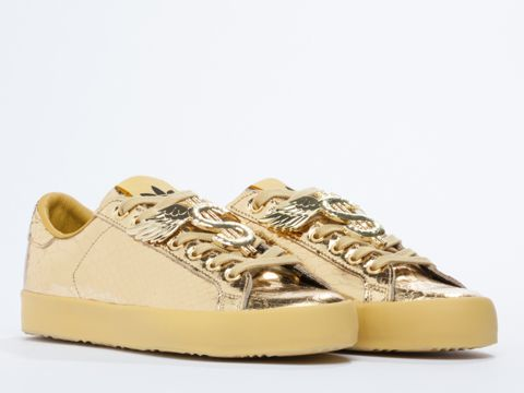 383ded3001b1 Adidas Originals x Jeremy Scott Gold Rod Laver low top sneakers with    money signs and wings in Metallic Gold at Solestruck.com