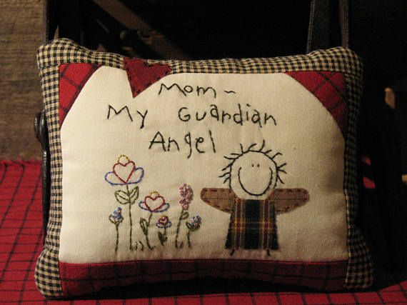 A sweet primitive stitchery pillow made especially for your mother. This smiling angel was hand stitched on muslin, with hand embroidered flowers. Using lots of homespun to border the front, I also added it to the back with additional cotton fabrics to give you a quilted look. Each