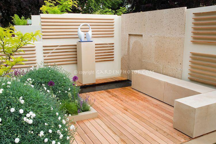 Garden ornament against modern wall deck patio dianthus for Garden decking ornaments