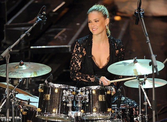 Drummer girl: Bar Refaeli surprised as she took to the stage at Sanremo 2013