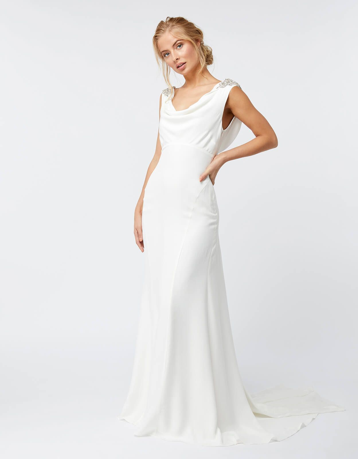 This Slinky Ivory Wedding Dress Features A Cowl Neckline An Empire Waist And Figure Flattering Mermaid Skirt The Embellished Shoulders Add Glamorous