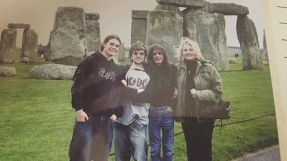 Malcolm Linda And Ross Young At Stonehenge With A Fan Acdc Malcolm Young Ac Dc Rock