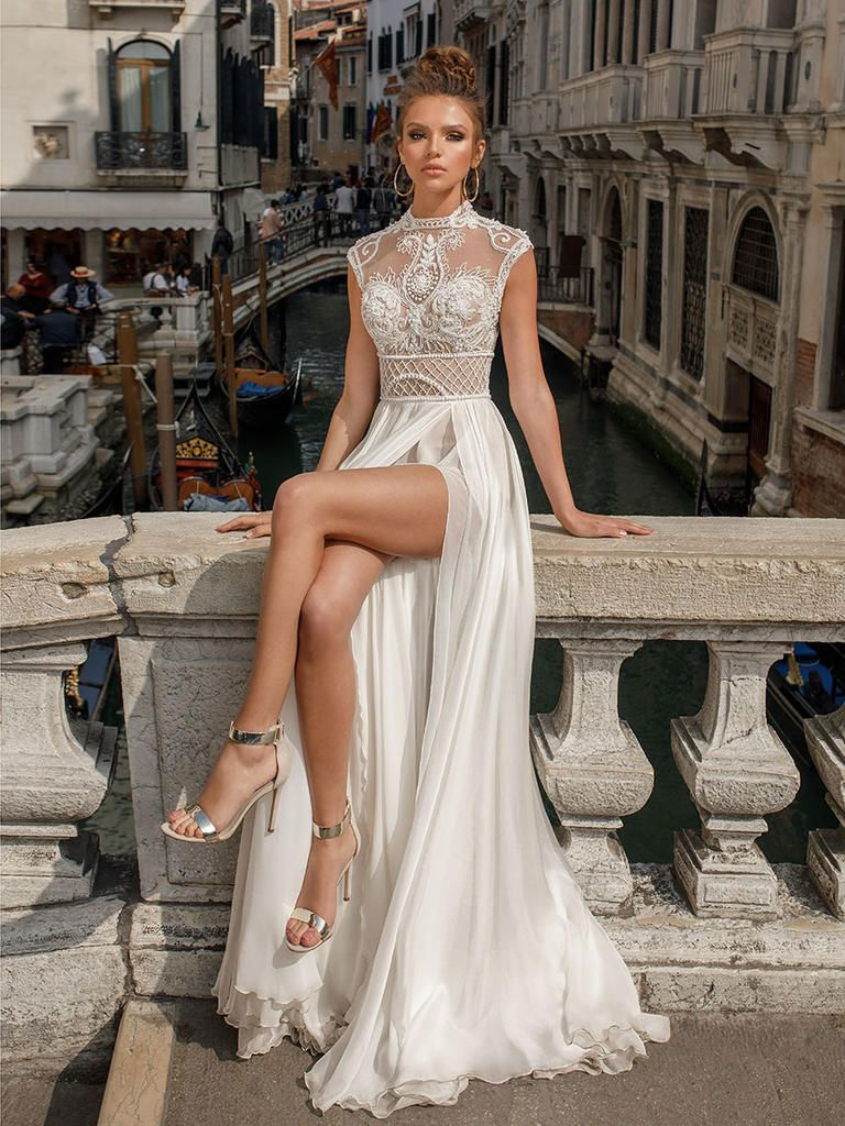 Aline wedding dress with sheer front slit skirt and cap sleeve