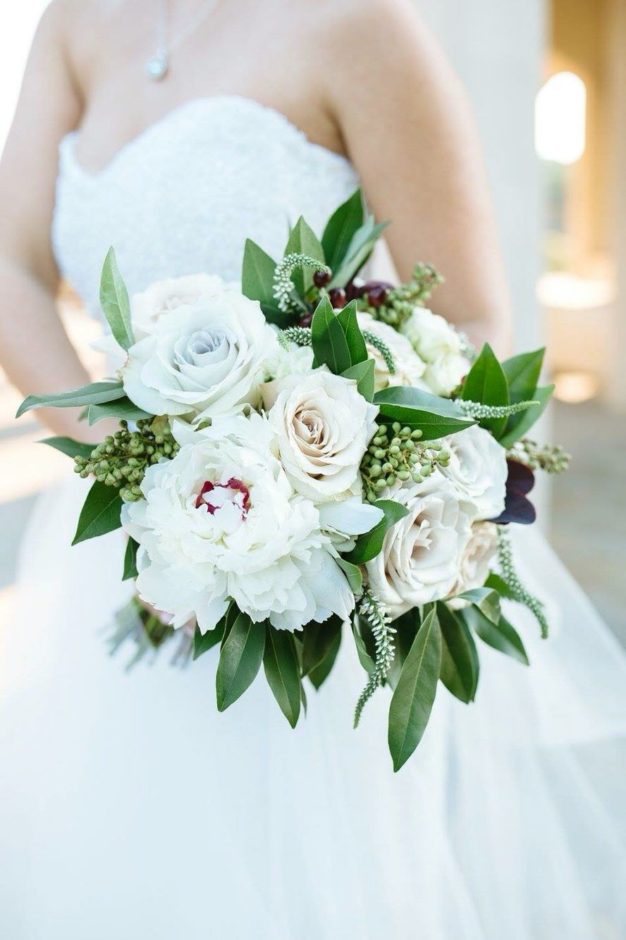 White Wedding Bouquets Done Right Just A Little Pop Of Color Paired With Muted Roses