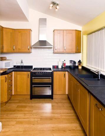 Golden Cabinets, Black Countertops