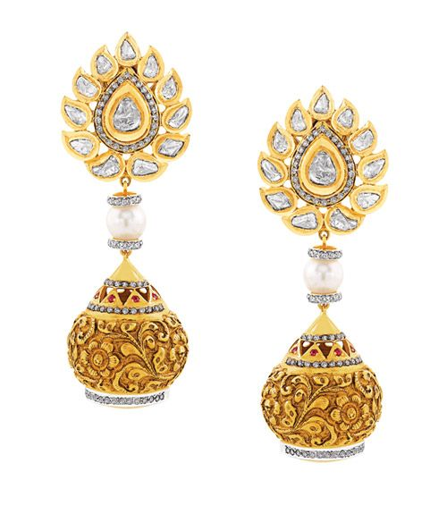A Beautiful Pair Of Earrings With Hanging Gold Spheres Engraved An Elegant Design