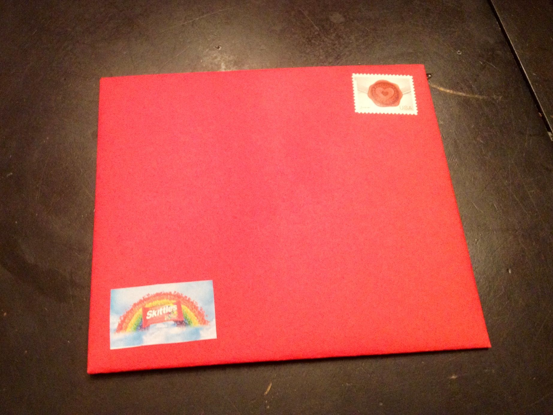 Home Made Envelope End Result With Taped On Skittles Logo To Continue Tie The