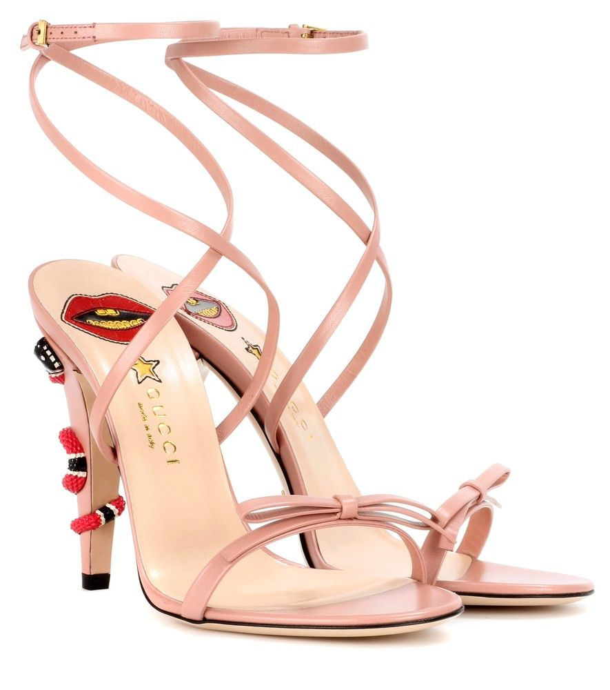 Gucci - Leather sandals - Opt for elegance with a vintage feel while donning Gucci's pink leather sandals. The strappy upper wraps around the ankle and is decorated with a bow at the toes, while the pointed heel features an iconic coral snake decoration. Wear yours as a seductive finish to retro-inspired ensembles. seen @ www.mytheresa.com