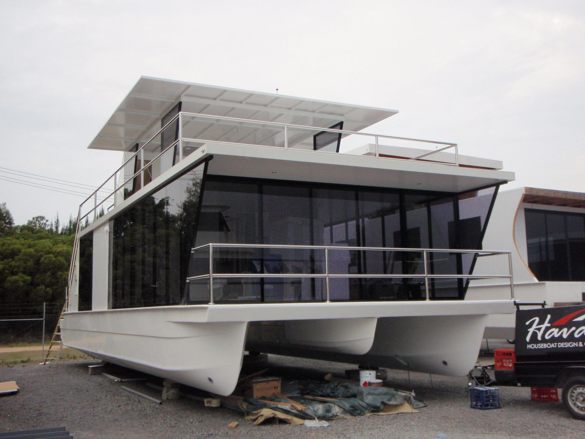 Houseboat/Homecruiser. Love the airy, sleek design.